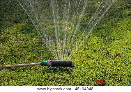 Oscillating garden sprinkler.