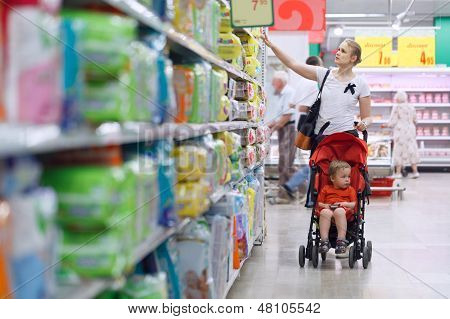 Mother with her boy in the supermarket