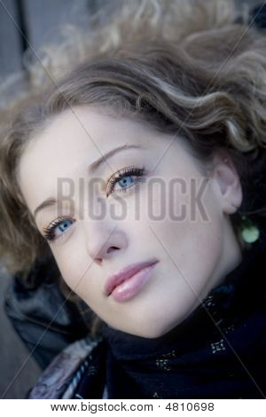 Closeup Portrait Young Curl Blond Woman With Blue Eyes