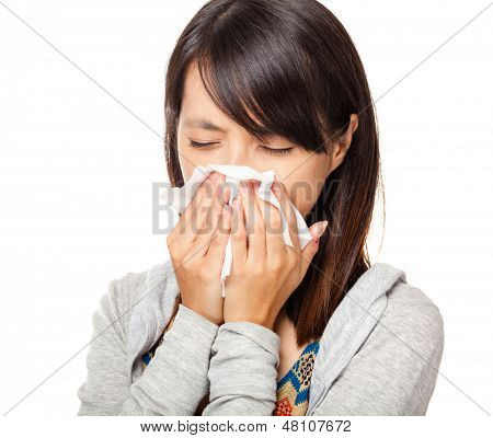 Sneezing woman isolated over white background