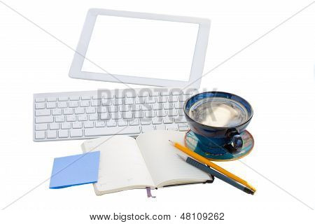 open notebook with key board and tablet