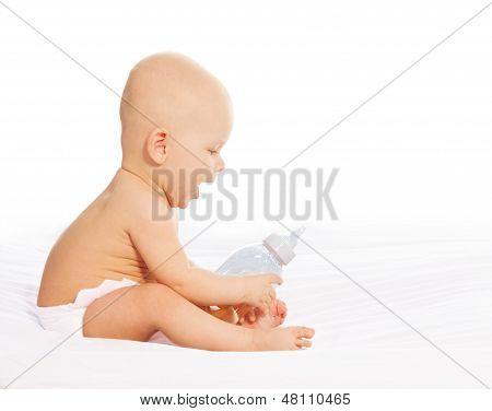 Little Boy With Baby Bottle