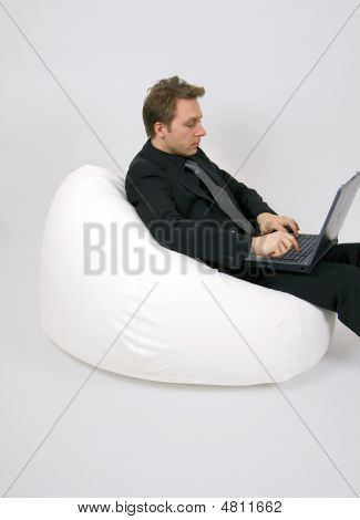 Businessman Sitting In A Fatboy