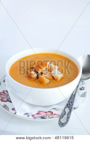 Pumpkin and red lentils cream soup with croutons