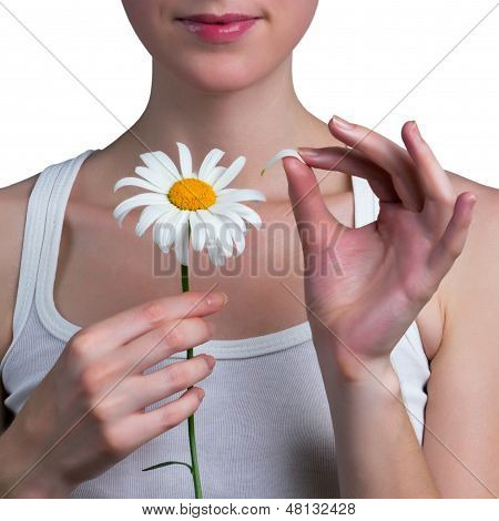 Young Girl Guesses On A Chamomile Flower
