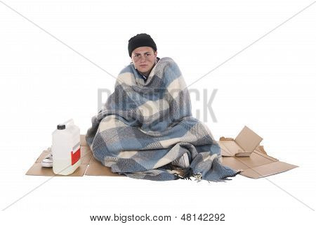 Homeless Sitting On Cardboard