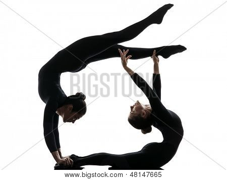 two women contorsionist practicing gymnastic yoga in silhouette   on white background