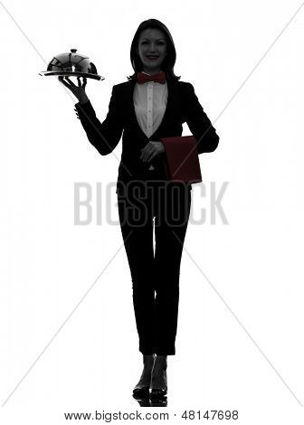one caucasian woman waiter butler serving dinner with catering dome in silhouette  on white background