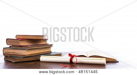 Diploma with old book