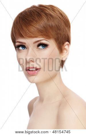Portrait of young beautiful woman with stylish short haircut looking upwards, over white background
