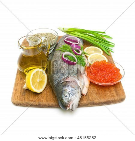 Fresh Raw Trout And Caviar On A Cutting Board. White Background.