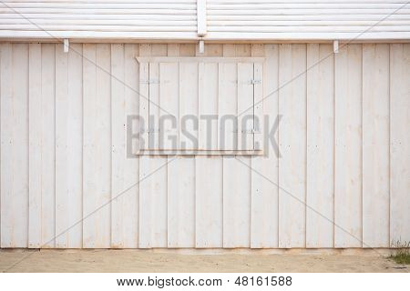 White Wooden Building Wall On Beach