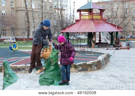 MOSCOW -  NOV 10: Anya (7), Dmitry (10) playing in playground with sculptures made by Krylovs fables, Nov 10, 2012 in Moscow, Russia. Ivan Krylov was born February 13, 1769, died November 21, 1844.