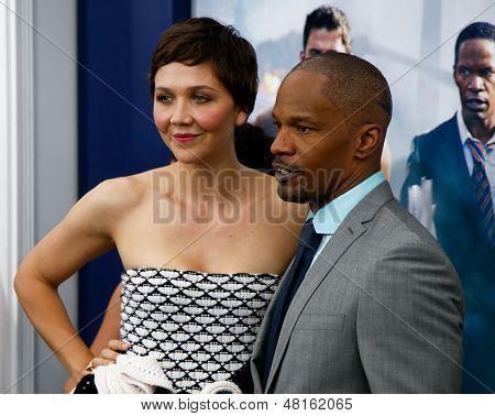 NEW YORK-JUNE 25: Actress Maggie Gyllenhaal (L) and Jamie Foxx attend the premiere of