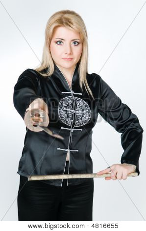 Woman In Japanese Shirt Holding Sword