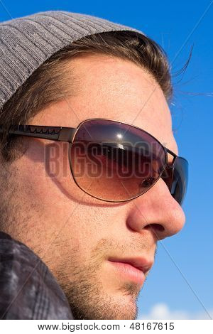 Brunette Man With Sunglasses And A Hat Looking