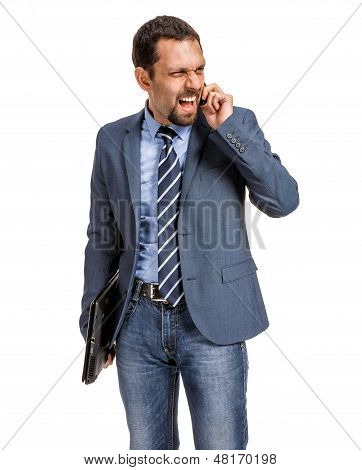 Angry businessman talking on the phone isolated over white background