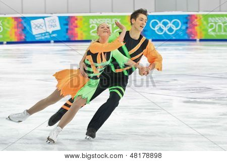 INNSBRUCK, AUSTRIA - JANUARY 17 Victoria-Laura Lohmus and Andrei Davodov (Estonia) place 12th in the pairs ice dance event on January 17, 2012 in Innsbruck, Austria.