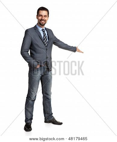 Happy businessman with arm out in a welcoming gesture, isolated on white background