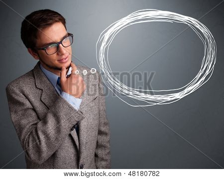 Good-looking young man thinking about speech or thought bubble with copy space