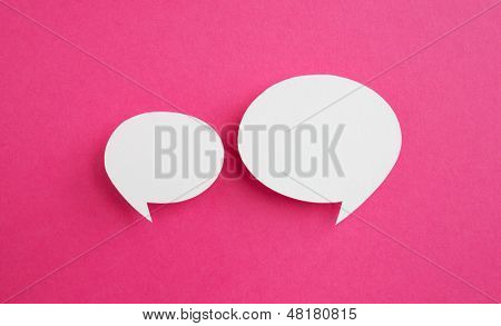 paper speech bubble on pink background