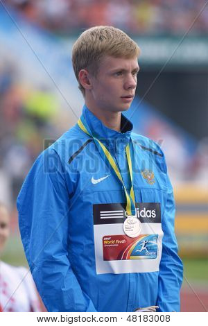 DONETSK, UKRAINE - JULY 14: Silver medalist in 800 metres Konstantin Tolokonnikov of Russia on medal ceremony during 8th IAAF World Youth Championships in Donetsk, Ukraine on July 14, 2013