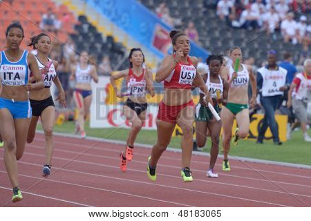 DONETSK, UKRAINE - JULY 14: Girls compete in the final round of medley relay during 8th IAAF World Youth Championships in Donetsk, Ukraine on July 14, 2013