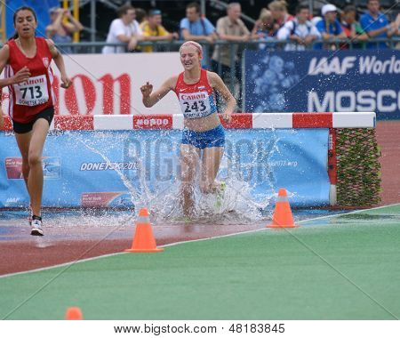 DONETSK, UKRAINE - JULY 14: Bouzayani of Tunisia (left) and Bozic of Croatia compete in the final of 2000 m steeplechase during 8th IAAF World Youth Championships in Donetsk, Ukraine on July 14, 2013