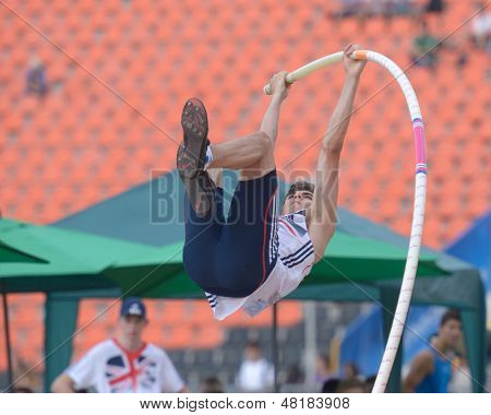 DONETSK, UKRAINE - JULY 14: Harry Coppell of Great Britain fight for his gold medal in the final in pole vault during 8th IAAF World Youth Championships in Donetsk, Ukraine on July 14, 2013