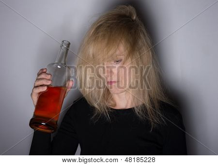 Alcoholic Woman Looks Down