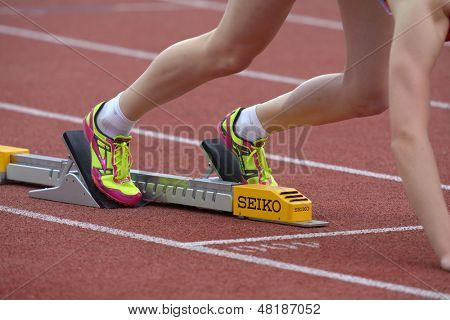 DONETSK, UKRAINE - JULY 13: Athlete prepares to the start in 400 meters hurdles during 8th IAAF World Youth Championships in Donetsk, Ukraine on July 13, 2013