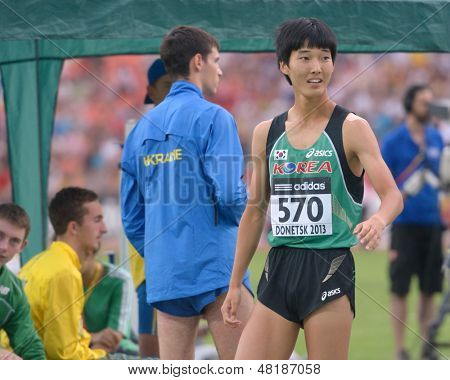 DONETSK, UKRAINE - JULY 13: Sanghyeok Woo of Korea fight for his gold medal in high jump during 8th IAAF World Youth Championships in Donetsk, Ukraine on July 13, 2013