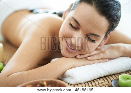 Portrait of young female ready for the procedure of massage