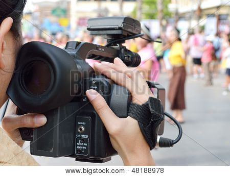 Cameraman Recording Video