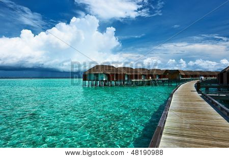 Beautiful beach with water bungalows at Maldives