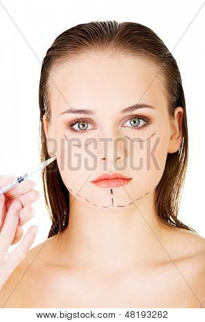 Cosmetic botox injection in the female face, isolated on white