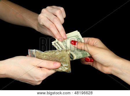 Dealer sells drug bag, isolated on black