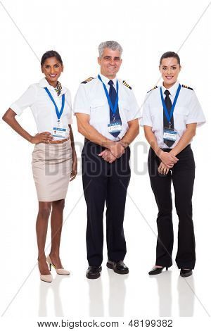 portrait of senior captain with airline crew on white background