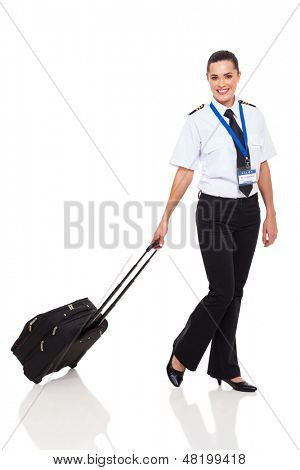 beautiful young woman in airline pilot uniform walking with briefcase on white background