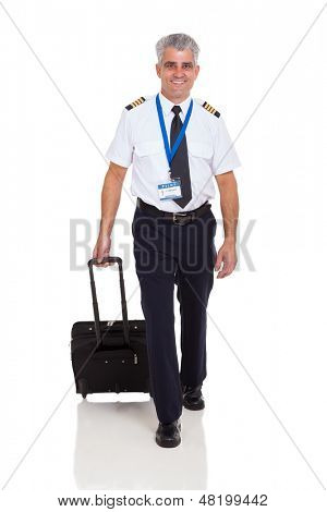 smiling senior airline pilot walking with briefcase on white background