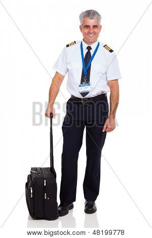 senior airline pilot wearing uniform standing next to briefcase