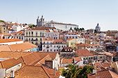 View of Alfama district with the Monastery of Sao Vicente de Fora and the baroque church of Santa En
