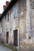 Bullets holes on building after war