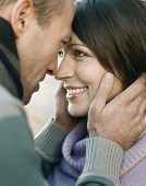 stock photo of side view people  - Closeup side view of a couple looking into each other - JPG