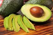 pic of avocado  - Sliced avocado on a cutting board with the seed