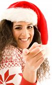 Latin American Model In Christmas Hat Pointing Towards