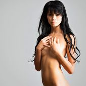 foto of chest hair  - Beautiful woman covers her naked breasts with her hand - JPG