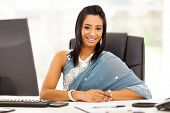 stock photo of sari  - modern indian businesswoman in traditional sari - JPG
