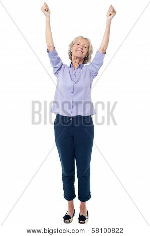 Full Length Image Of Excited Aged Lady