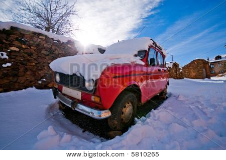 Antique Car At Sunset In The Snow.